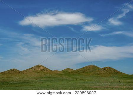 A Series Of Interesting Hills Break Up The Otherwise Flat Prairies Of Western Nebraska Beneath A Bea