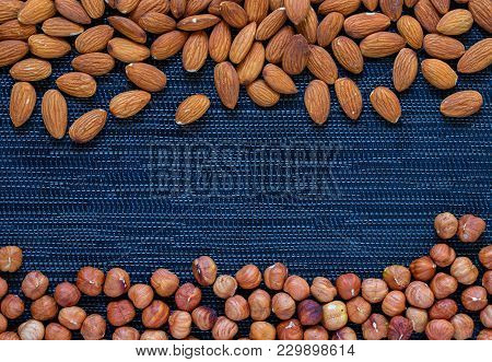 Almond And Hazelnut On Dark Background. Almond And Hazelnut Photo. Organic Food Rustic Banner Templa