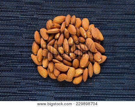 Almond Pile On Dark Background. Almond Macro Photo. Organic Food Rustic Banner Template. Tasty Healt