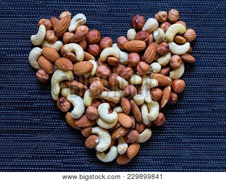 Nut Heart On Dark Background. Almond, Cashew, Hazelnut Nuts. Organic Food Rustic Banner Template. Ta
