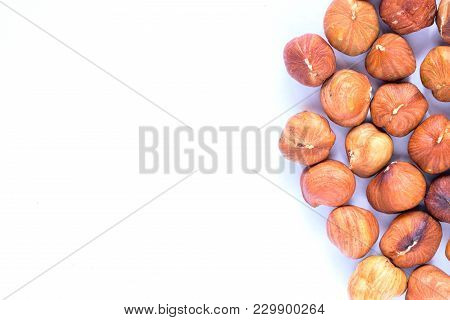 Hazelnut Pile On White Background. Hazelnut Photo. Organic Food Rustic Banner Template With Text Spa