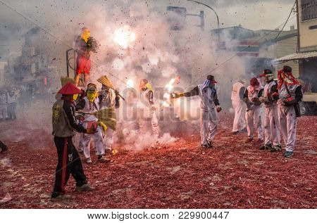 TAITUNG, TAIWAN - MARCH 2 : Firecrackers with people at Master Han Dan on march 2nd, 2018, Taiwan. Traditional Lantern Festival ceremony in Taitung, Taiwan. Fire crackers throw a man's bod