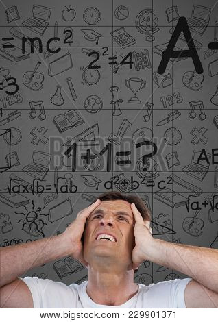 Digital composite of frustrated man with math background