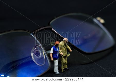 Old Couple And Optical Glasses Macro Scene. Senior Age Couple Walking With Support. Aged People Heal