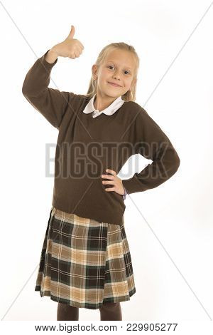 Portrait Of 7 Or 8 Years Old Beautiful And Happy Schoolgirl Female Child In School Uniform Smiling C