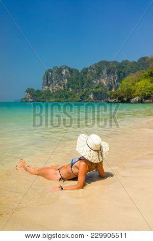 woman resting at the  tropical Thailand Railay beach