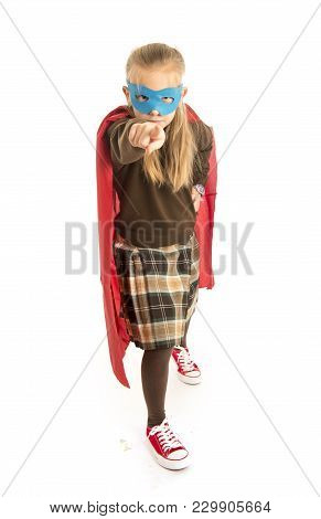 7 Or 8 Years Old Young Female Child In Super Hero Costume Over School Uniform  Performing Happy And