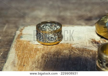 The Work Of Jewelers. Trial Jewelry Of Semiprecious Metals. Ring. Selective Focus. Macro Photo.