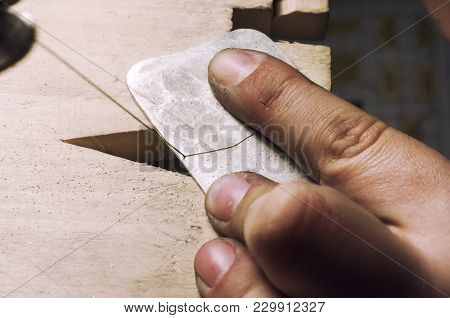 Jewelry Maker Cutting Sterling Silver With A Band Saw