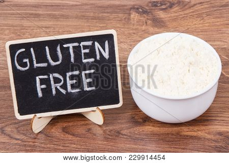 Inscription Gluten Free And Millet Flour In White Glass Bowl, Concept Of Healthy Food