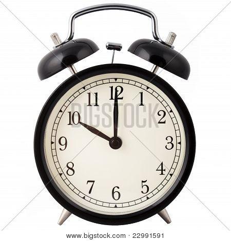 Alarm clock set for 10 o'clock.