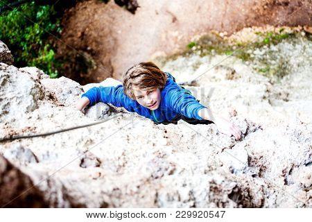 The Boy Climbs The Rock.