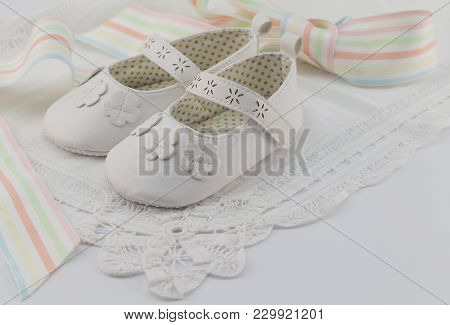 Baby Booties Background With White Lace And Pastel Colour Ribbon, Suitable For Babtism, Christening,