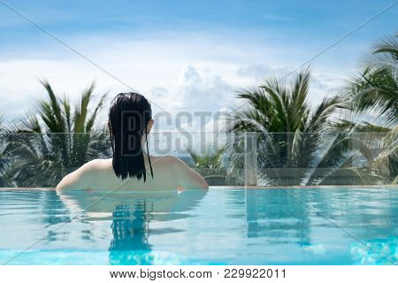 Sexy Woman In Bikini Swimming Suit Relaxing In The Luxury Private Swimming Pool On The Beach With Pa