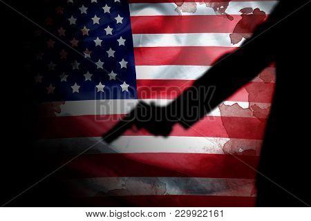 Handgun In Gunman Hand With Blood Stain On American Flag. Reform Gun Control In America Concept