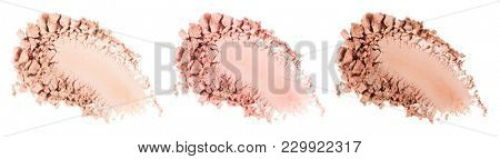 Face powder. Smears of foundation for face. Cosmetic smear. Make up crushed powder. Isolated on white background