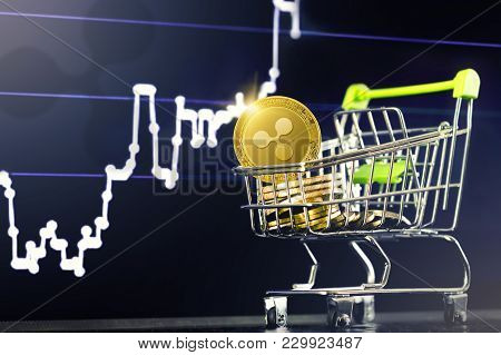 Ripple Cryptocurrency; Shopping Cart (trolley) With Gold Physical Ripple (xrp) Coins On The Backgrou