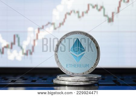 Ethereum (eth) Cryptocurrency; Physical Concept Ethereum Coin On The Background Of The Chart