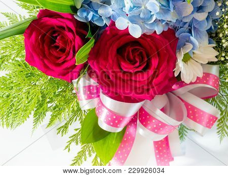 Big Red Roses And Small Blue Fragile Flowers Insert Leaves In The Beautiful Flower Bouquet