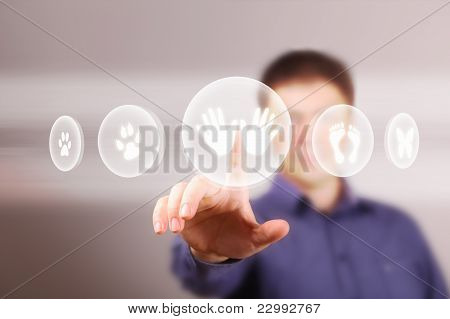 Man touching screen with buttons on it