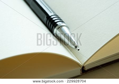 Top View Of Businessman  Blank Notebook Business Document Black Pen
