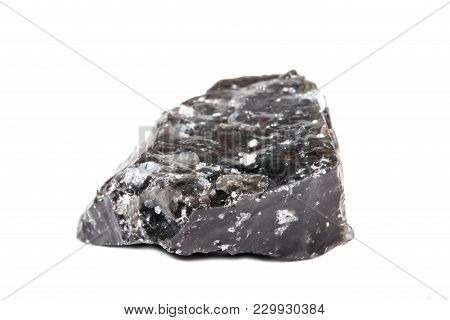 Macro Shooting Of Natural Gemstone. The Raw Mineral Is Obsidian, Indonesia. Isolated Object On A Whi