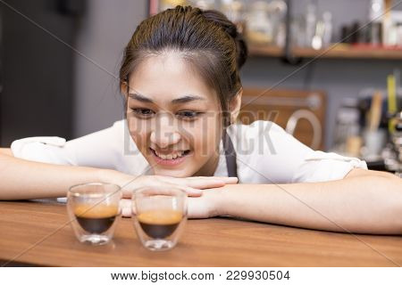 Asian Barista Woman Making Coffee In The Coffee Shop. People With Barista In Cafe Concept.