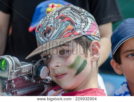 Latrun, Israel - May 02, 2017: Little Boy Looking Into The Scope