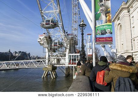 London, Uk: February 24, 2018: The London Eye In London Attracts Thousands Of Tourists Every Day. Lo