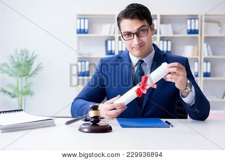Laywer with diploma roll in legal profession eductional concept