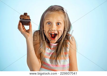 Young Beautiful Crazy Happy And Excited Blond Girl 8 Or 9 Years Old Holding Donut On Her Hand Lookin