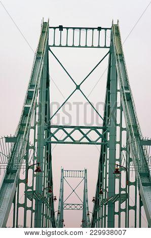Metal Construction Of Pedestrian Bridge Across The Dnieper In Kyiv, Ukraine. Winter Morning.