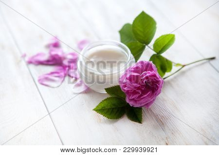 Organic Cosmetic With Rose And Pot Of Moisturizing Face Cream On White Background Top View