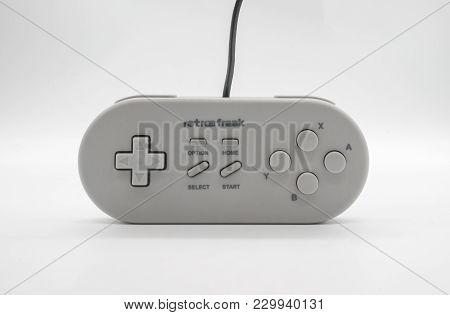 Bangkok, Thailand - March 7, 2018: Retro Freak Controller In White Color, Vintage Portable Game From
