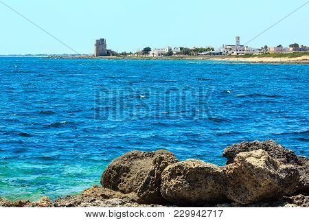 Picturesque Ionian Sea Torre Colimena Beach,  Salento, Puglia, Italy.  Historical Fortification Towe