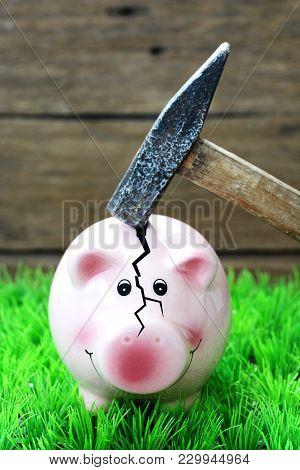 Broken Piggy Bank By Hammer, Financial Crisis Concept