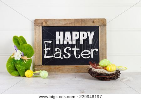 Easter Scene With Colored Eggs In Nest And Easter Green Rabbit, With Happy Easer Greetings
