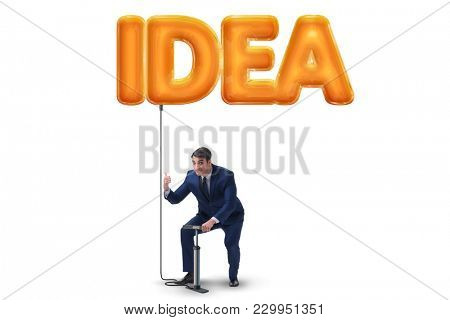 Businessman pumping innovative idea balloon