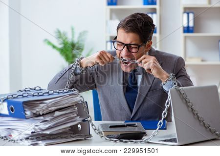 Busy employee chained to his office desk