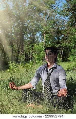 young guy on nature meditates