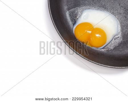 White Background With Egg In A Frying Pan