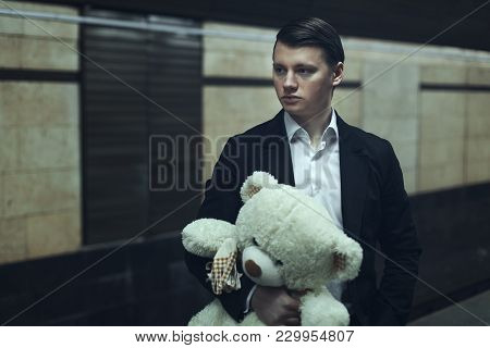Sad Young Guy Holds A Stuffed Toy And Waits For A Lover.