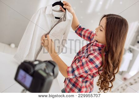 Young Shopaholic. Charming Petite Pre-teen Girl Recording A Shopping Video Blog And Talking About He