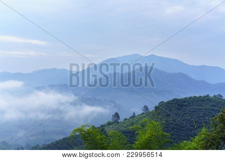 Beautiful Green Mountains Covering By Fog At Phu Huai Isan In The Morning , Nong Khai , Thailand