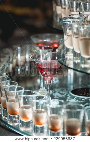 Different Alcohol Drinks On A Glass Stand. Wine, Champagne, Cognac, Vodka Martini