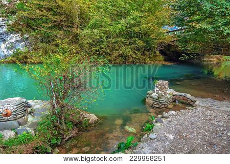 Blue Lake In The Autumn. Abkhazia, Near The Lake Ritsa.