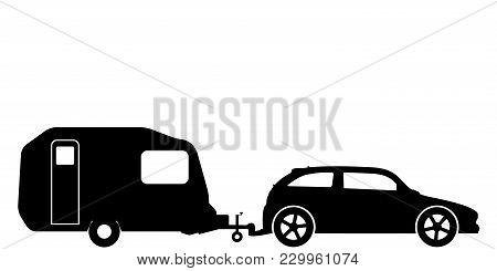 A Silhouette Of A Hatchback Car Towing A Caravan