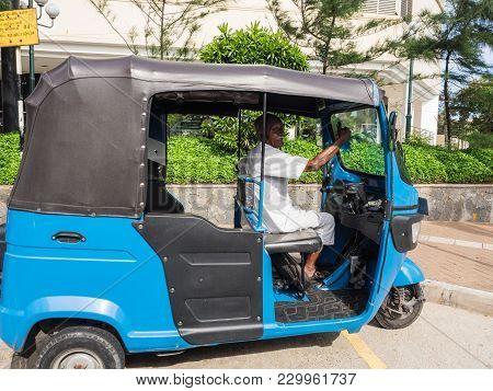 Colombo, Sri Lanka - November 11, 2017: An Unidentified Elderly Driver Waiting For Passengers  In Hi