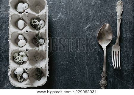 Natural Easter Table Decoration With Silverware On Black Stone