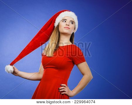 Xmas, Seasonal Clothing, Winter Christmas Concept. Young Neutral Confident Woman Wearing Santa Claus